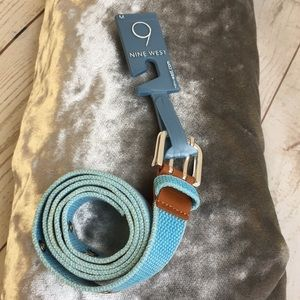 Blue cotton belt with metal grommets